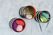 Shells made from tin cans for storing sewing utensils