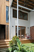 Contemporary house with narrow terrace on wooden platform