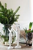 Festive still-life arrangement of fir sprigs and deer figurines