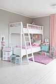 White bunk beds with latter in corner of children's bedroom painted pale grey