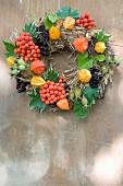 Autumn wreath of rowan berries, box, Chinese lanterns, vine leaves & rose hips
