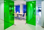 Hallway & conference room with green glass doors in modern office building
