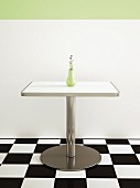 American-style café: metal table on chequered floor