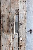 Old board door with hatch