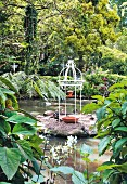 Small wrought iron pavilion in garden pond