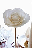 Elegant, white paper rose as festive table decoration