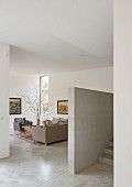 Modern living area with concrete floor and wall