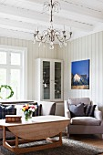 Rustic living room with wood-beamed ceiling and wood-panelled walls