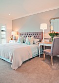 Double bed with upholstered headboard and arranged pillows