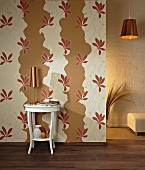 Wall decorated with cut-out sections of floral wallpaper over beige paint