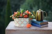 Autumn still-life arrangement of berries, teapot and old books