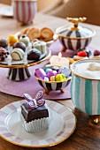 Chocolates on plate and cake stand and bowls of sweets