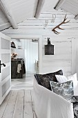 View into Scandinavian log cabin through panelled door