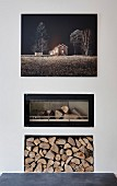 Edited landscape photo on wall above modern fireplace with glass front and firewood niche