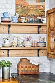 Teacups and saucers on wooden shelf