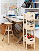 DIY shelves for stationary made from wooden crates, vintage wooden table and stool on sisal rug