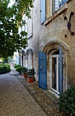 Mediterranean country house with blue shutters on doors