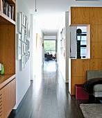 Narrow hallway in partially open-plan interior