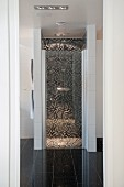 Floor-level separate shower area with mosaic tiles in designer bathroom