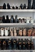 Ladies' shoes on metal shelves in shoe cabinet