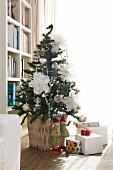 Christmas tree decorated with hand-crafted stars made from white doilies