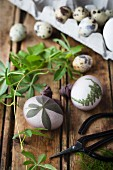 Dying Easter eggs using herb leaves