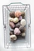 Balls of pastel wool in shopping basket