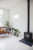 Houseplants and log burner in Scandinavian living room
