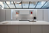 White designer kitchen with counter below skylight