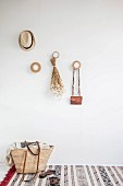 Shopping basket in cloakroom made from round wooden discs