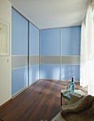 DIY wardrobes with floor-to-ceiling, blue sliding doors