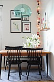 Retro table and black Windsor chairs