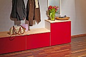 Red shoe cabinet in cloakroom