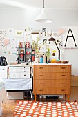 Retro chest of drawers and collage in workspace