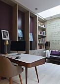 Elegant retro-style desk and chair, custom-made floor-to-ceiling cabinets with integrated bookshelves, framed records and mural of musical notation