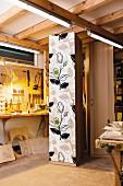 Cupboard with fabric covered door in workshop