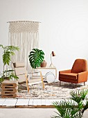 Armchair, designer stool, serving trolley, macrame wall hanging and house plants