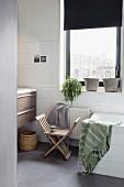 X-chair in bathroom in shades of grey