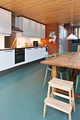 Dining table in kitchen of industrial loft apartment