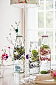 Bottles of mineral water flavoured with berries and slices of lime