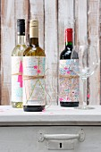 Wine bottles wrapped in maps as gifts