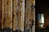 Rustic wooden door and milk churn