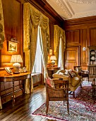 Grand interior with panelled walls and heavy curtains