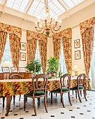 Floral curtains in classic dining room
