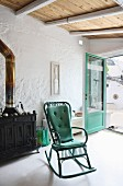 Turquoise rocking chair in Mediterranean interior