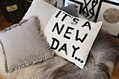 Scatter cushion hand-painted with the motto 'It's a new day...'