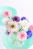 Pastel posy of cornflowers and love-in-a-mist