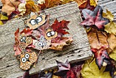 Owls painted on pressed autumn leaves