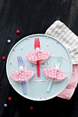 Colourful plastic forks with paper collars made from cake cases