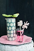 Drinking straws with paper collars and pink drink in glass